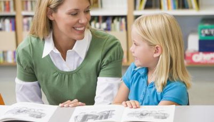 Teacher smiling next to kindergartener