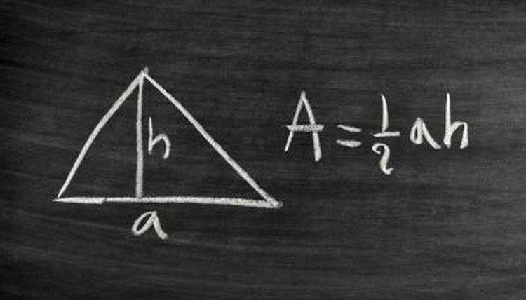 Triangle area formula written on chalkboard.
