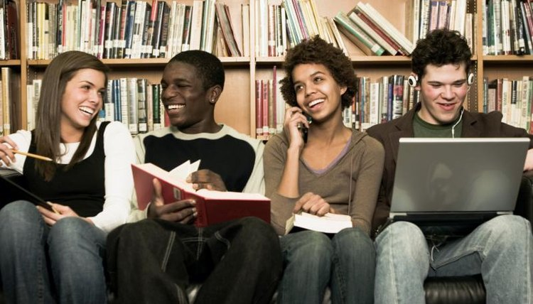 Group of smiling high school students in library.