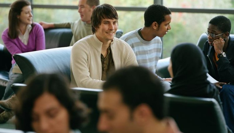 Students talking in a common room.