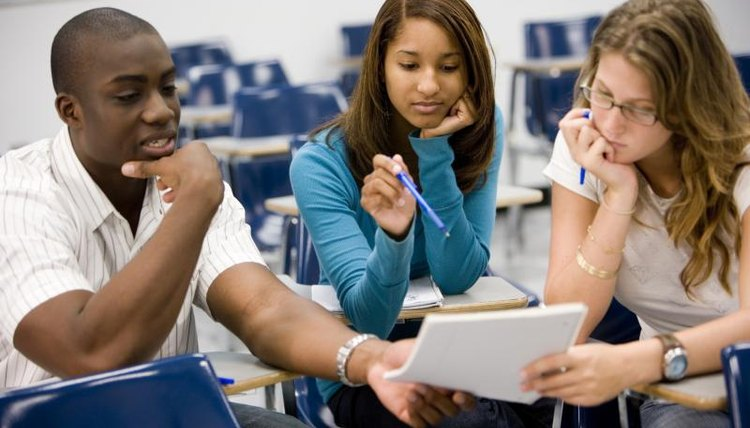 College students having a group discussion in classroom.