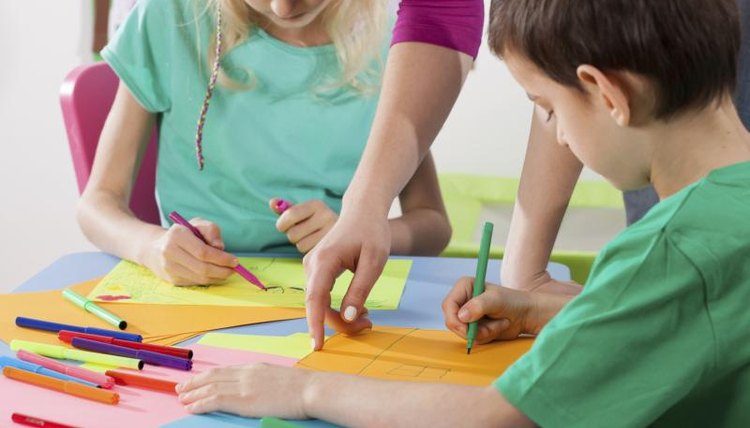 Close-up of young children working on crafts