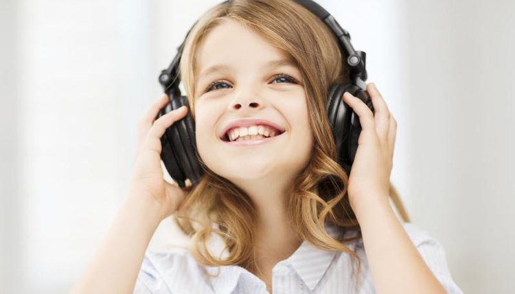 Young child listening to music on headphones