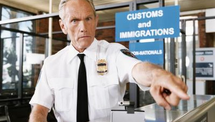 Security will ask to see your green card, as well as a valid passport, at the airport.