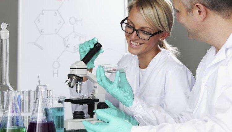 Biochemistry student working in laboratory with professor.