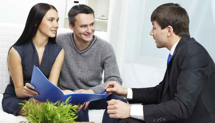 A young couple meeting with a tax professional