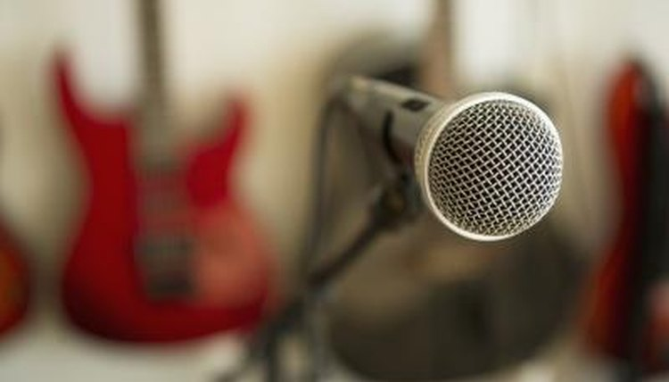 A close-up of a microphone in a room with instruments.