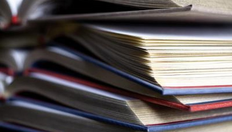 Close-up on pile of text books