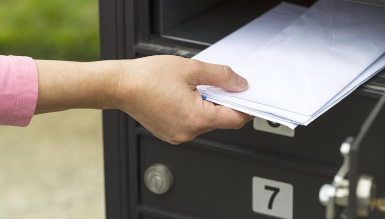 Woman getting mail out of mailbox