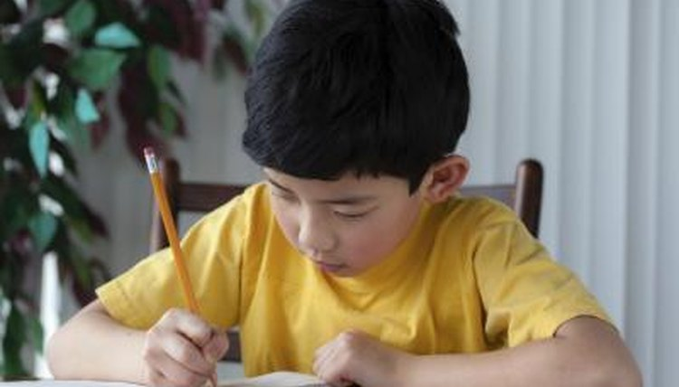 Nonverbal child writing on piece of paper