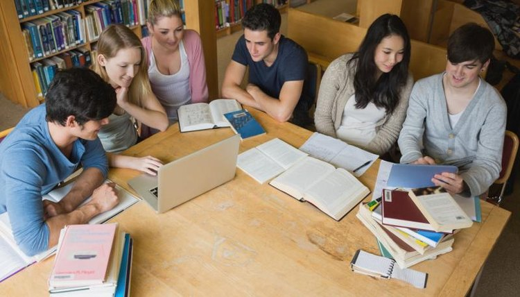 Group of students studying in the library.