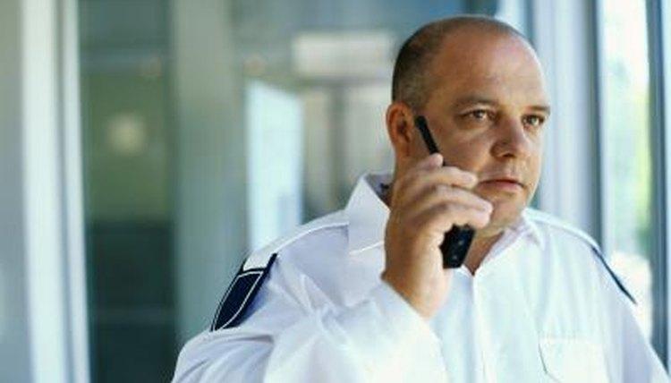 Security guard talking on a walkie talkie.