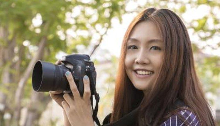 High school student holding DSLR camera