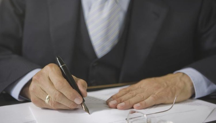 A lawyer signing a legal document.