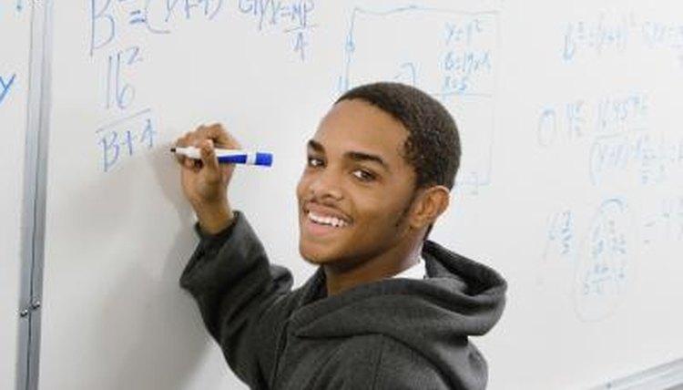 Student working on Algebra problems on whiteboard.