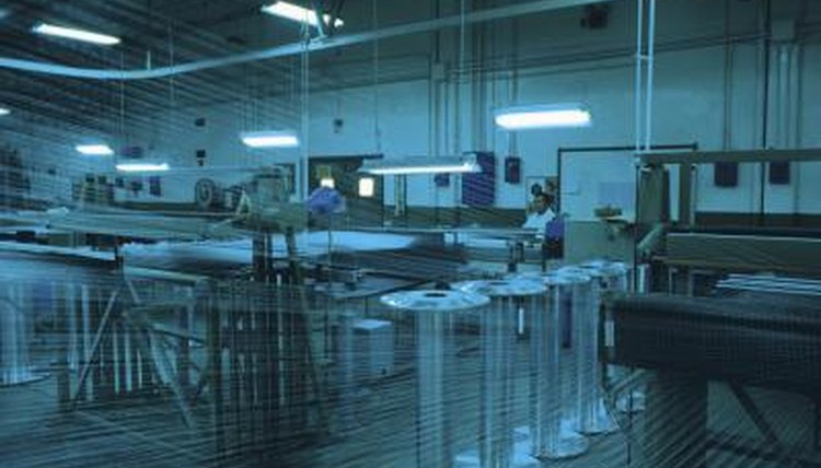 Worker in plastic manufacturing plant