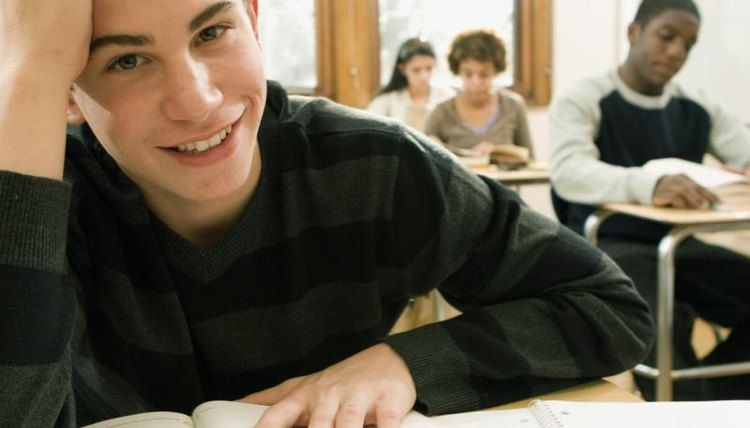 A portrait of a high school student smiling in class.