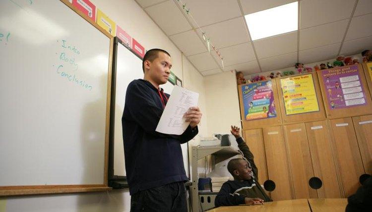 Teenage boy giving a speech in a classroom.