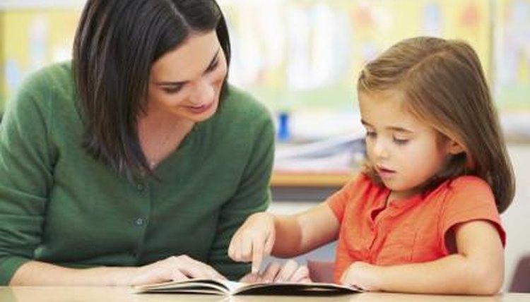 Elementary school student reading for teacher.