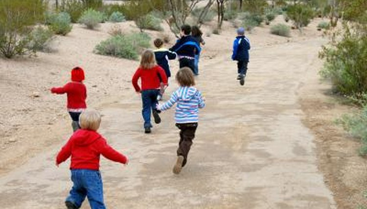 Children running down path