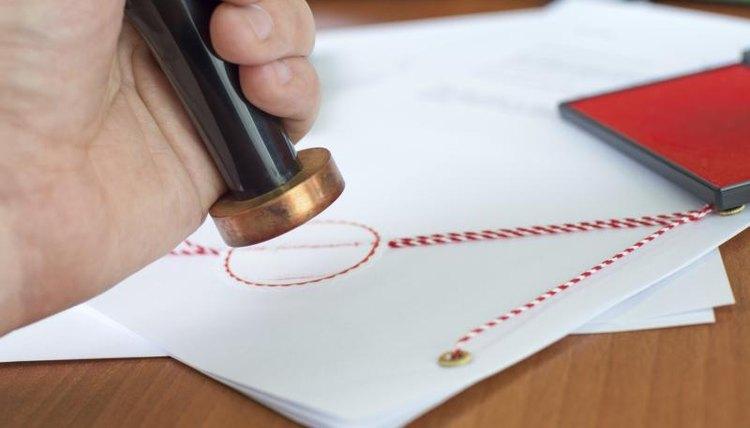 A close-up, a clerk, a legal document