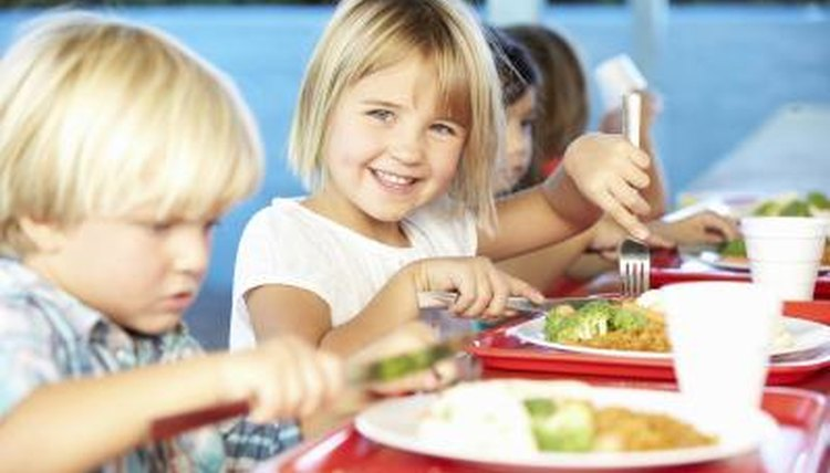 Use a reward system to manage behavior in an elementary school lunchroom.