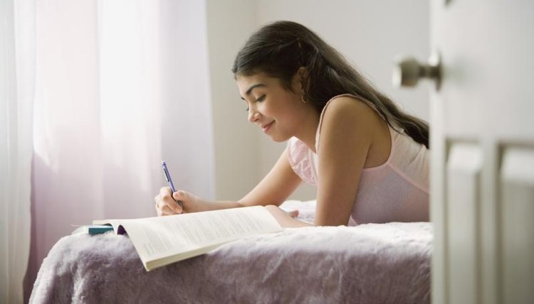 Student studying in bedroom