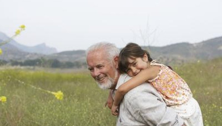 Grandfather, his granddaughter, a field