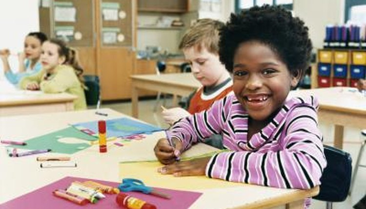 Smiling young children in classroom.