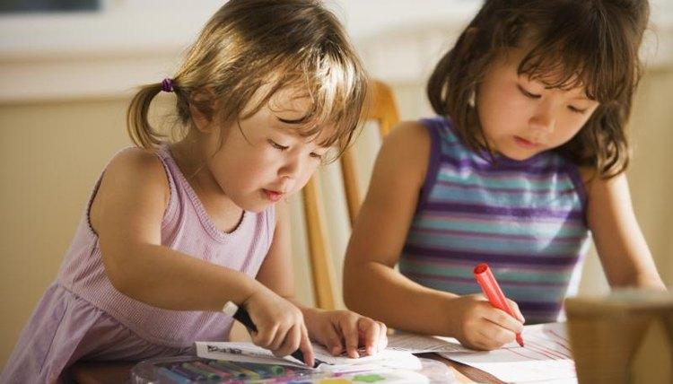 Preschoolers coloring in classroom.