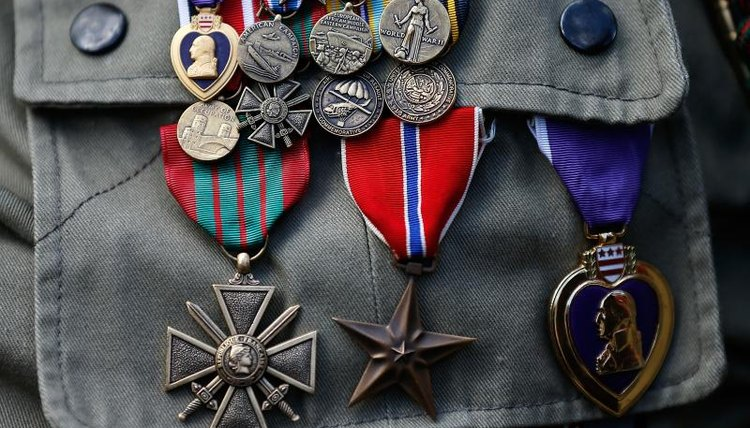 Close-up of veteran medals on pocket.