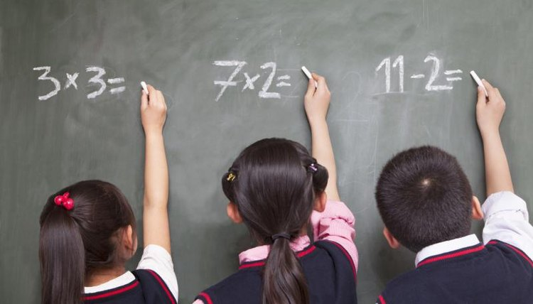 Young students are solving math problems.