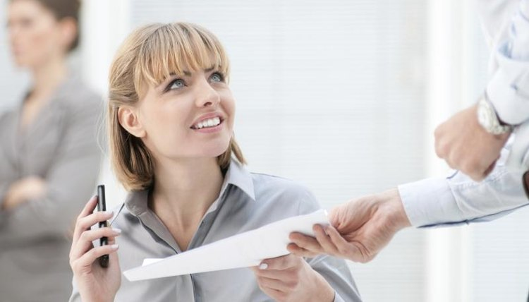 A woman is looking at a business letter.