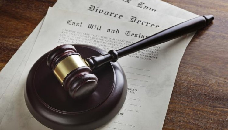 A gavel, top, legal documents, a court bench