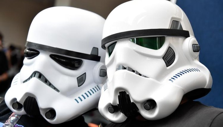 Close-up of students wearing Star Wars helmets