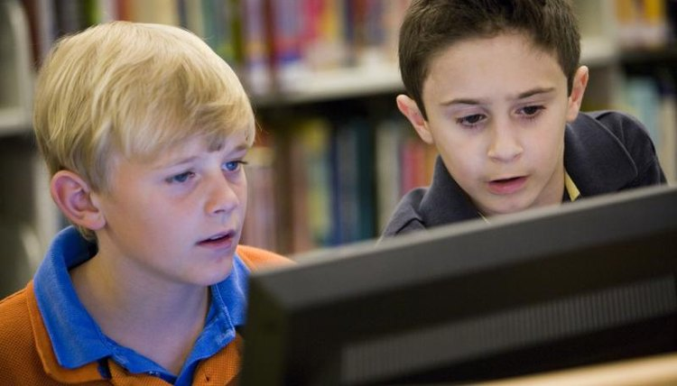 Seventh-grade students learn how to locate reliable research material online.