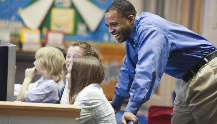 Smiling teacher in school classroom.