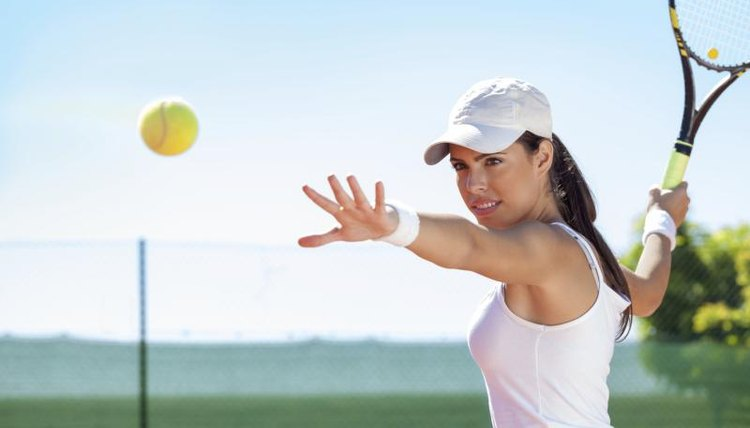 A woman is about to hit a tennis ball.