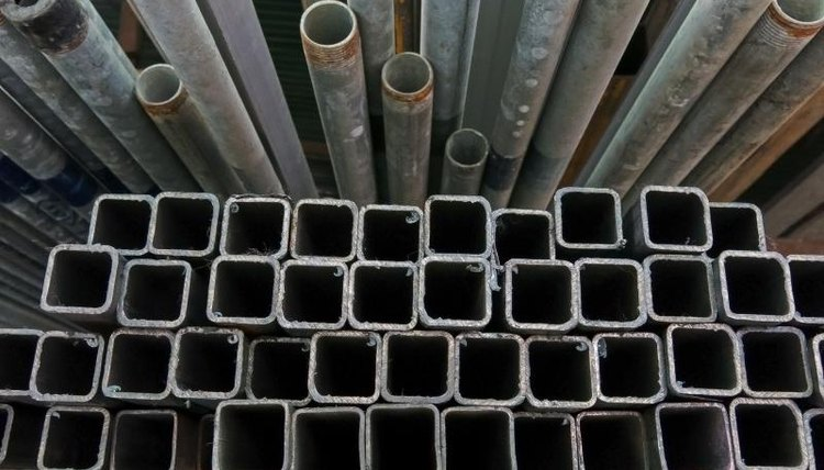 A stack of steel pipes of various sizes