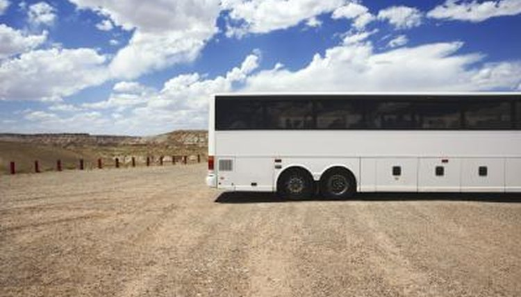 Bus parked in dirt lot