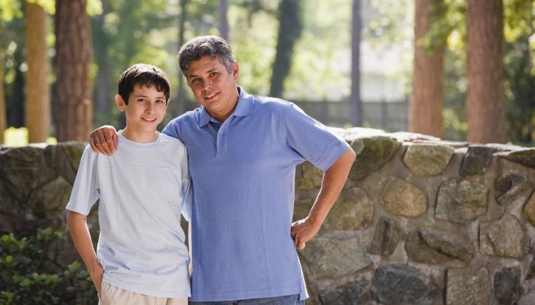 Young boy with his father.