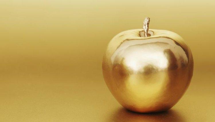 Golden apple in golden studio.