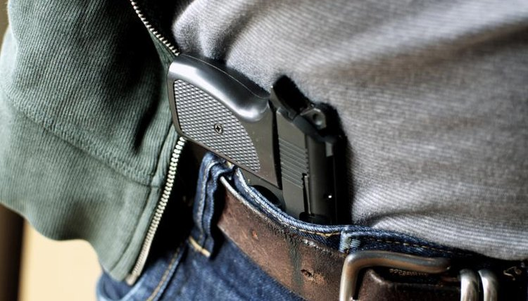 You must wear handguns in plain view in North Carolina, unless you have a concealed carry permit.