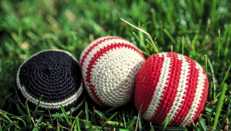 Close-up of hacky sacks on grass field.