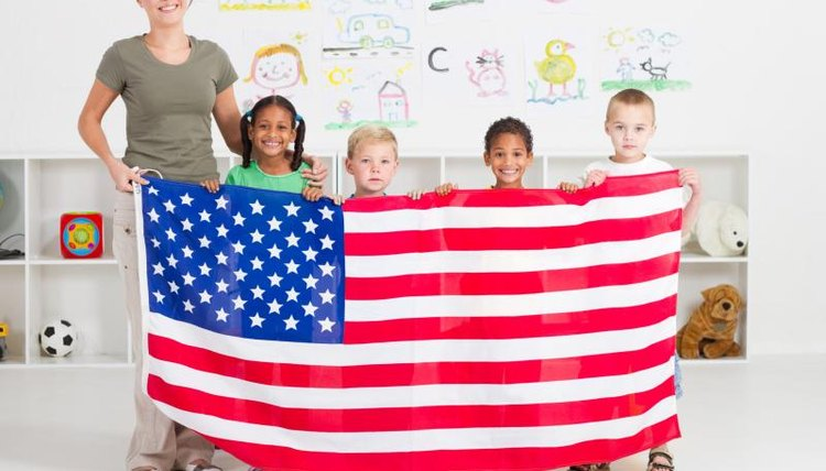 Teacher and students holding an American Flag.