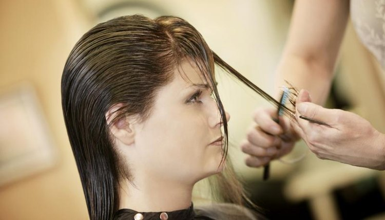 Woman having her hair trimmed.