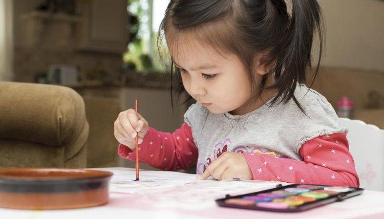 Preschooler using art supplies at home