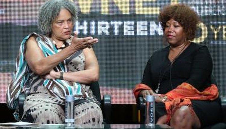 Ruby Bridges sitting on stage next to journalist