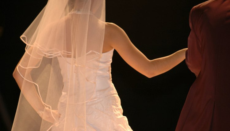 Image of the backs of a bride and groom.