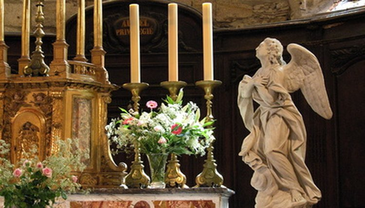 Use candles, flowers and religious symbols to decorate the altar.